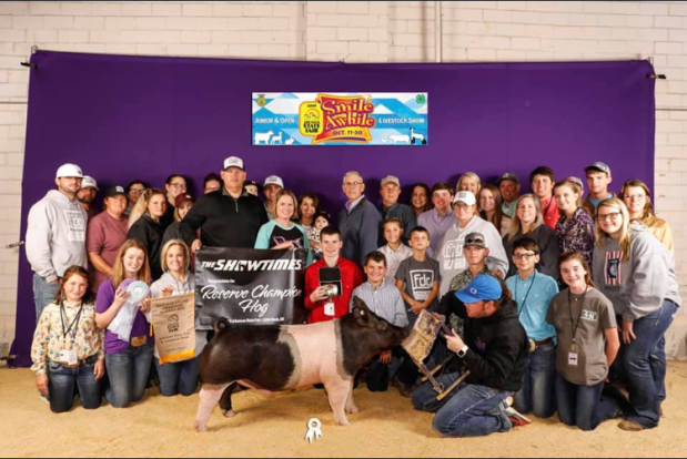 Colton Thomas and his Reserve Grand Champion Hog and the Purple Circle Club