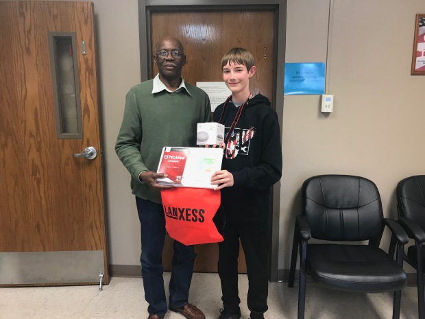 Principal Beasley and a Middle School Student Presenting LanXess' Door Prize
